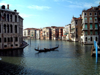 Venice Grand Canal with gondola in middle of canal